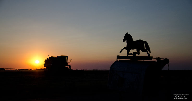 silhouette-tractor-sunset-rural